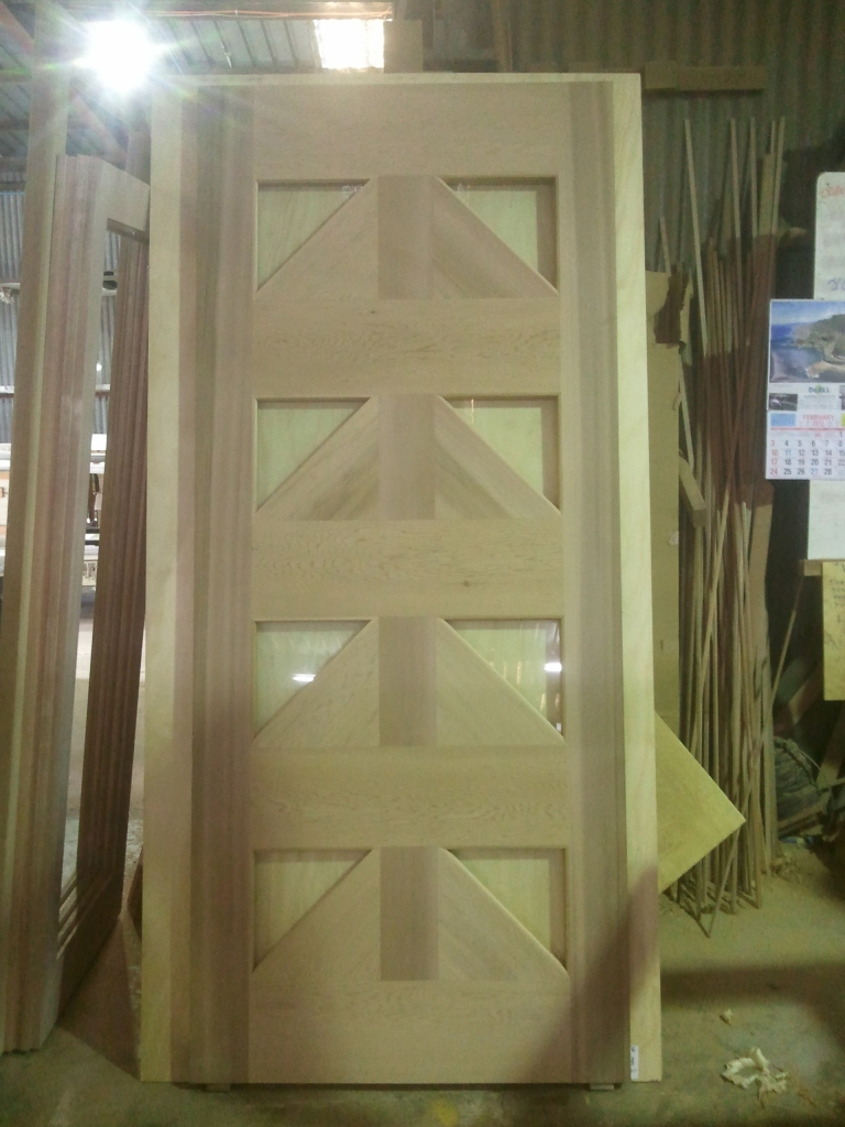 Front door with triangle glass panels, as per clients design.