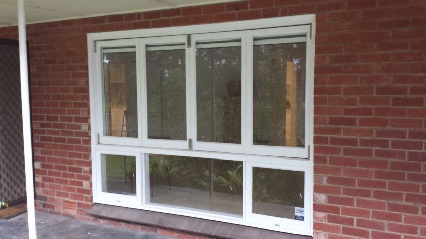 Timber bifold window painted white