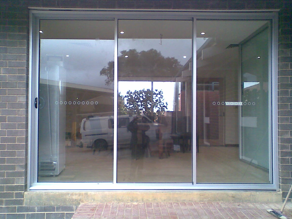 3 panel sliding door the window man for Sliding barn doors for patio