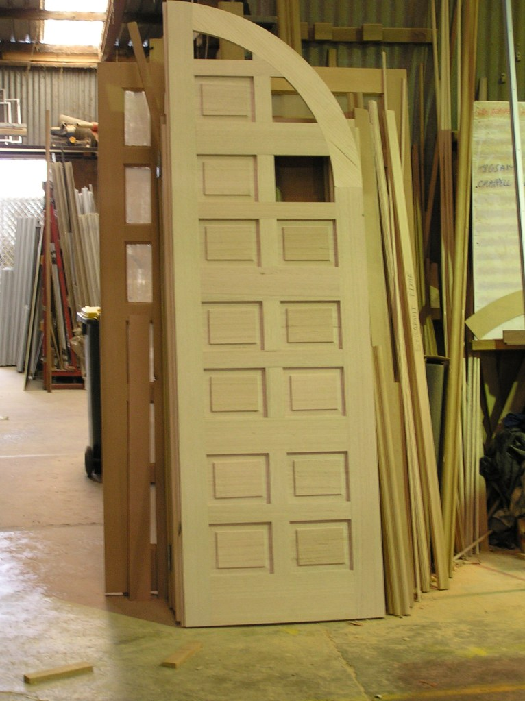1 of 2 arched french doors with panels