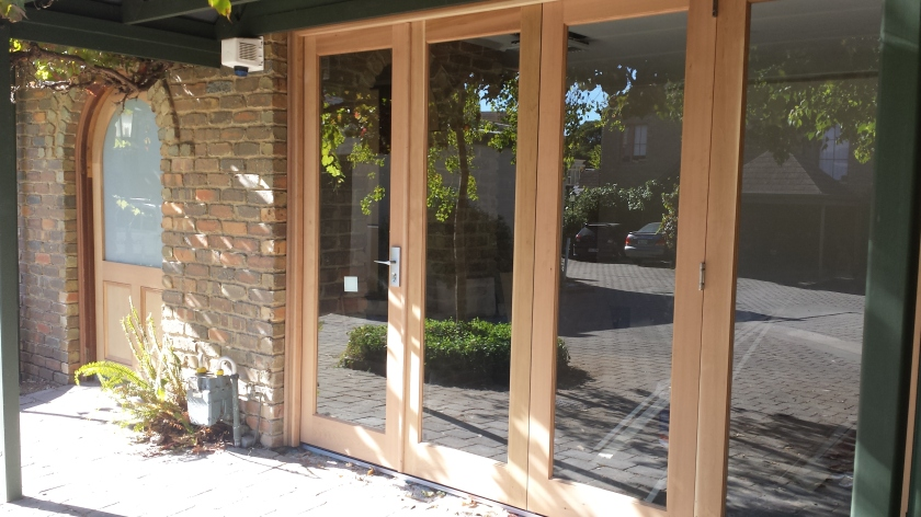 4 panel WRC bifold door + arched front door.