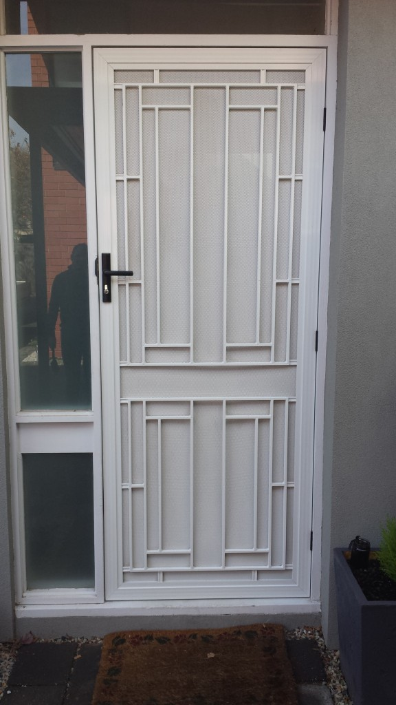 Decorative Grille door in Pearl White powdercoat.