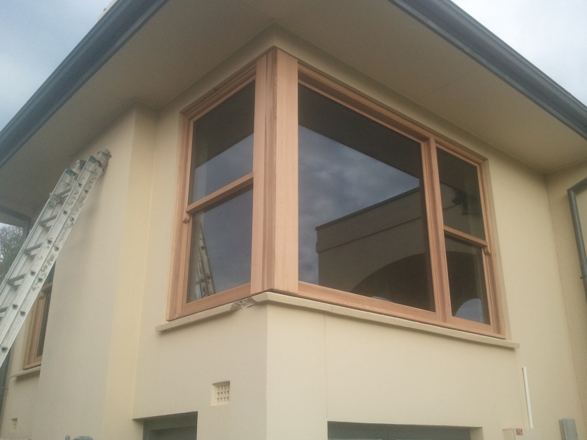 Western Red Cedar Corner window with double glazed lift up sashes.