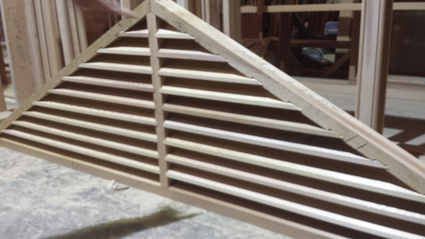 Western Red Cedar Gable window with fixed timber louvre slats - slats notched into the frame not nailed over the top. work in progress. flywire to be added on back, and finished nearly on facia with extra timber beading. LOTS of manhours.