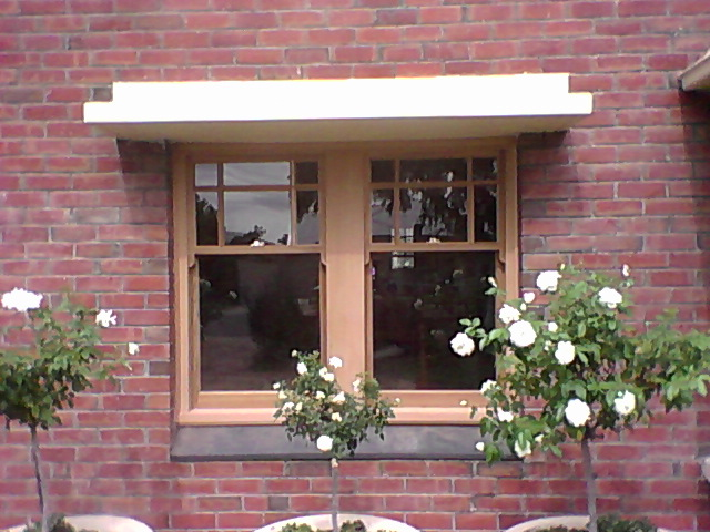 Western Red Cedar lift up windows with square shouldered colonial bars