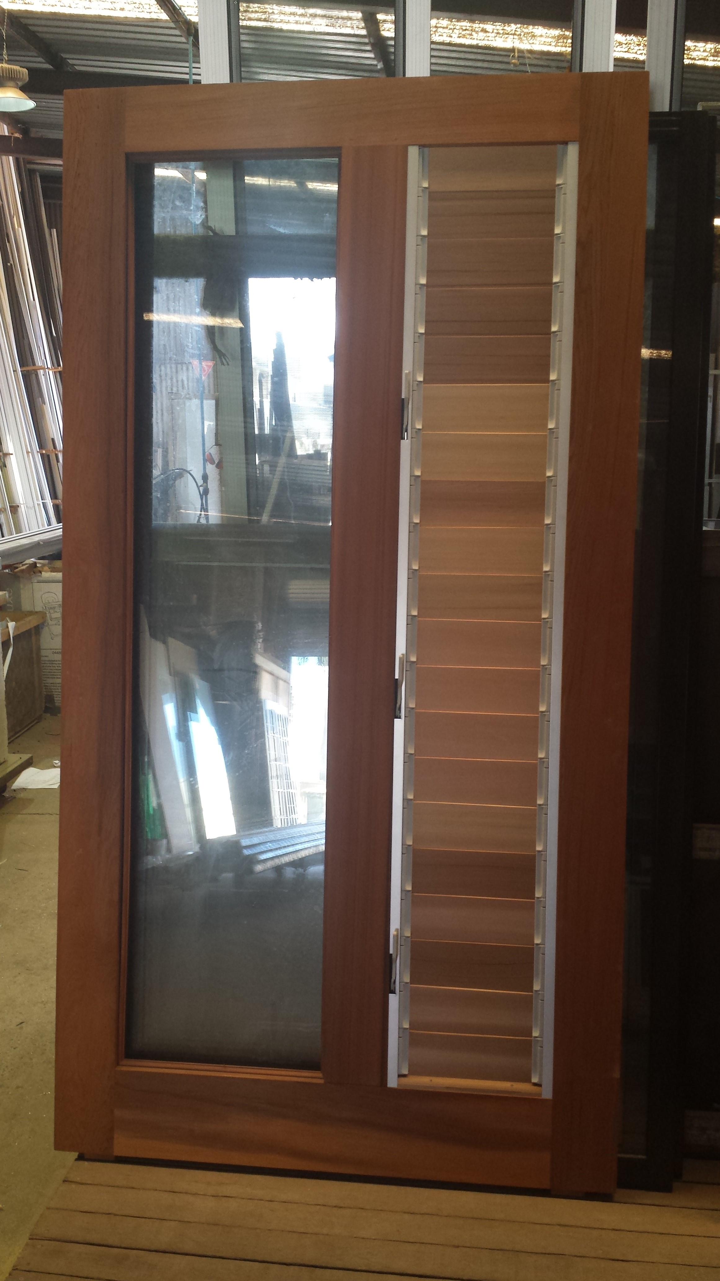 Western Red Cedar Pivot door with timber louvres panes. Ready to be installed! & Pivot door with timber louvres \u2013 THE WINDOW MAN