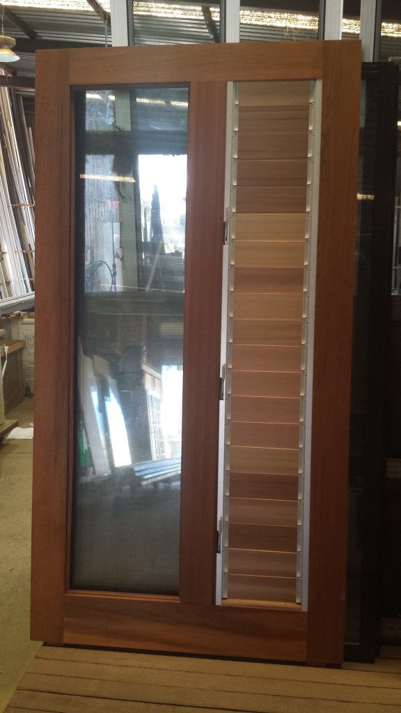 Western Red Cedar Pivot door with timber louvres panes.  Ready to be installed!