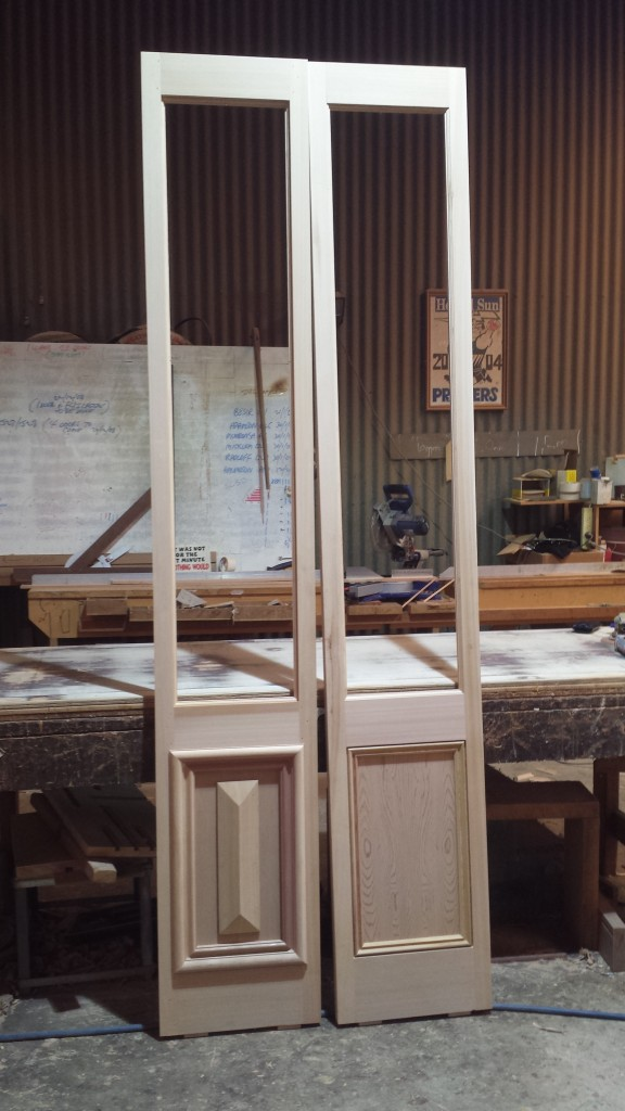 French doors with paneling.  Western red cedar