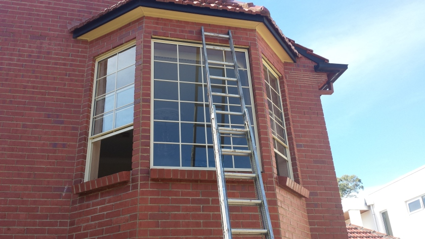Primrose aluminium lift up windows with colonial bars.