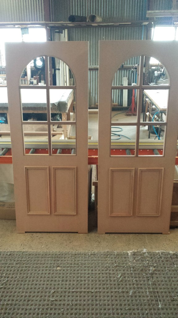 Solid doors with colonial bars and arched glass. unglazed.