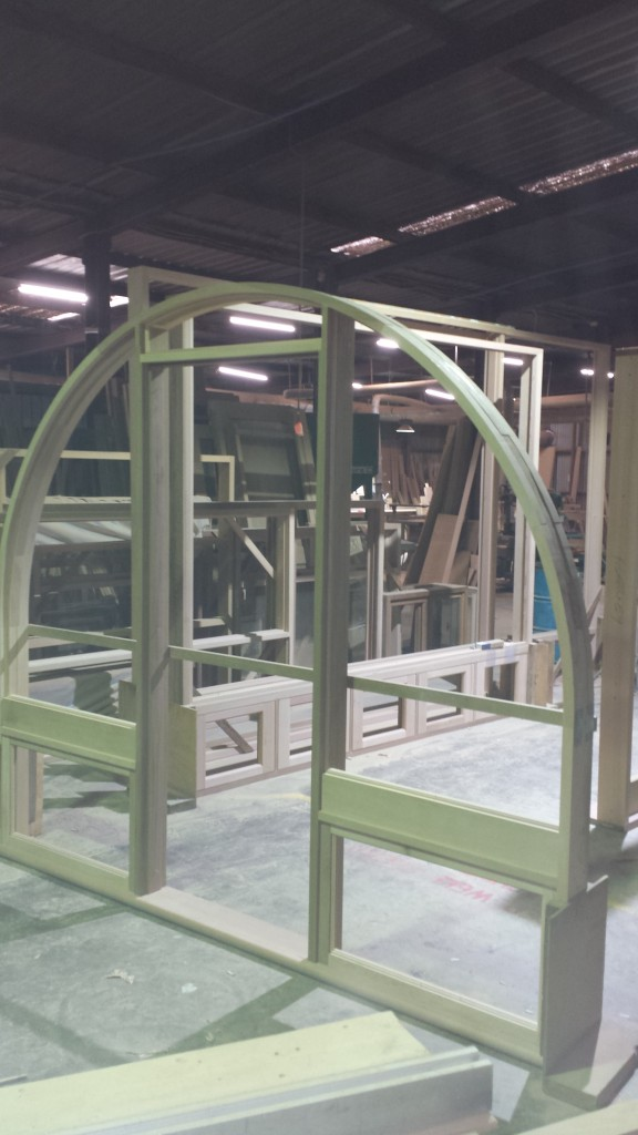 Arched doorframe with awning sidelites.