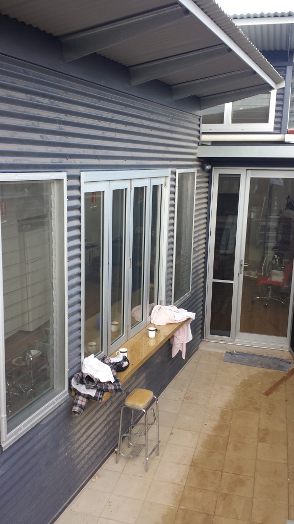 Outside view of the commercial windows and doors. the bifold is top hung to allow for a marble bench top servery