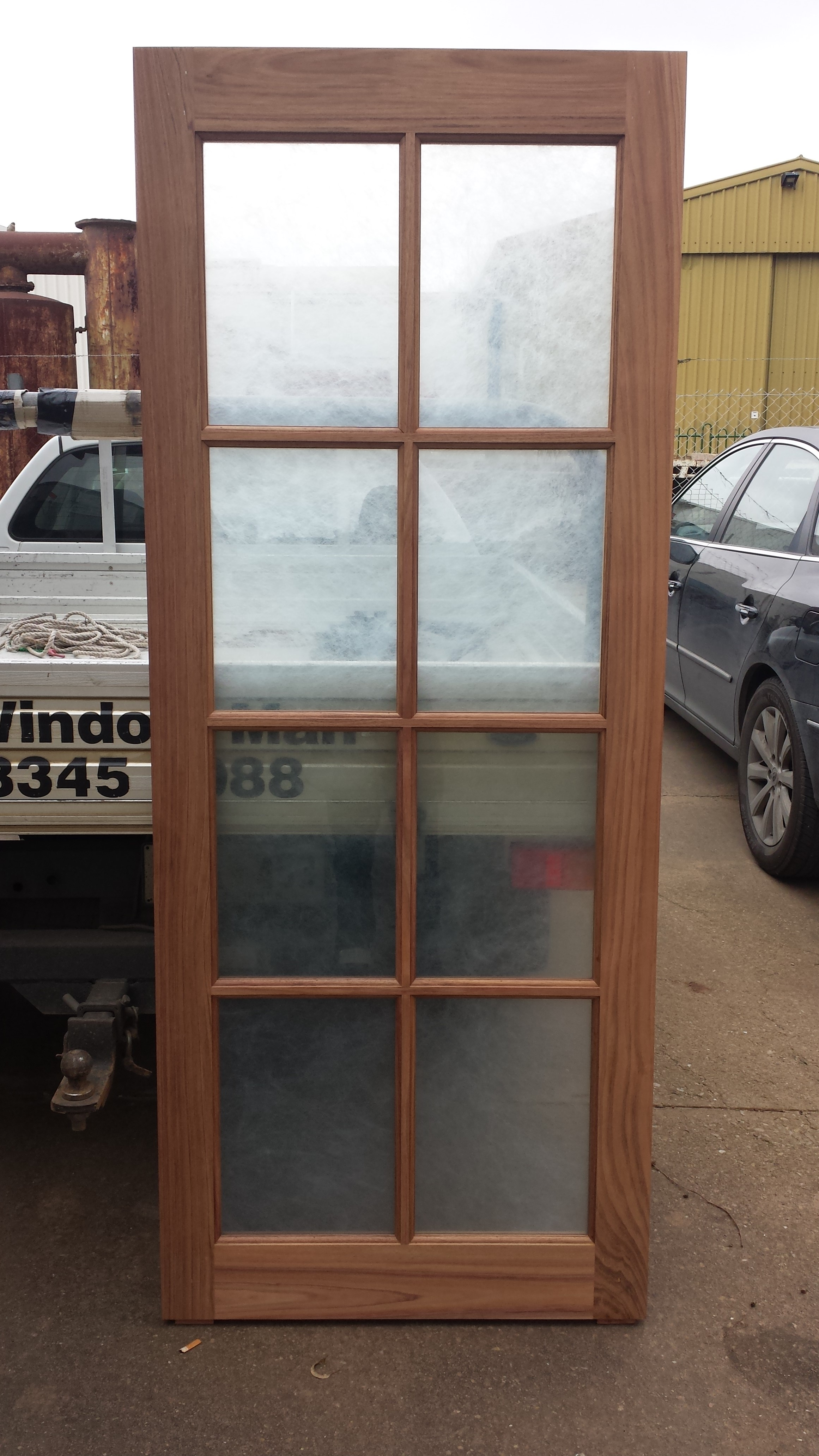 Door Made Out Of Blackwood And Rice Paper Laminate Safety Grade Glass.