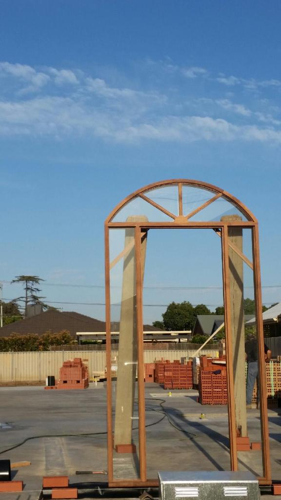 Merbau arched door frame with sidelites and arched hi lite with colonial bars radiating out.