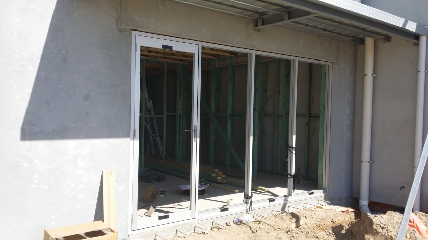 Clear Anodise series 400 commercial framing with hinged door.