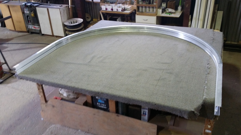 Here is mill (raw) alumimium commercial frame we have engineered to a curve. we will then make a window from it.