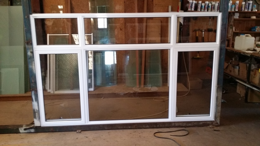 white aluminium awning window with clear glass, flyscreens and lockable winders.