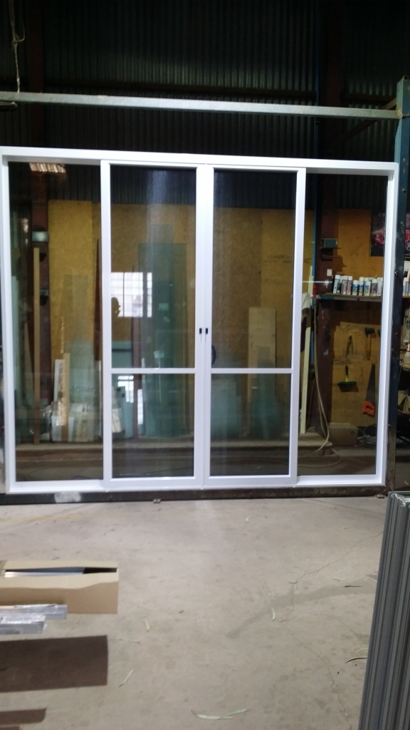 2525 high x 2995 wide white aluminium sliding door