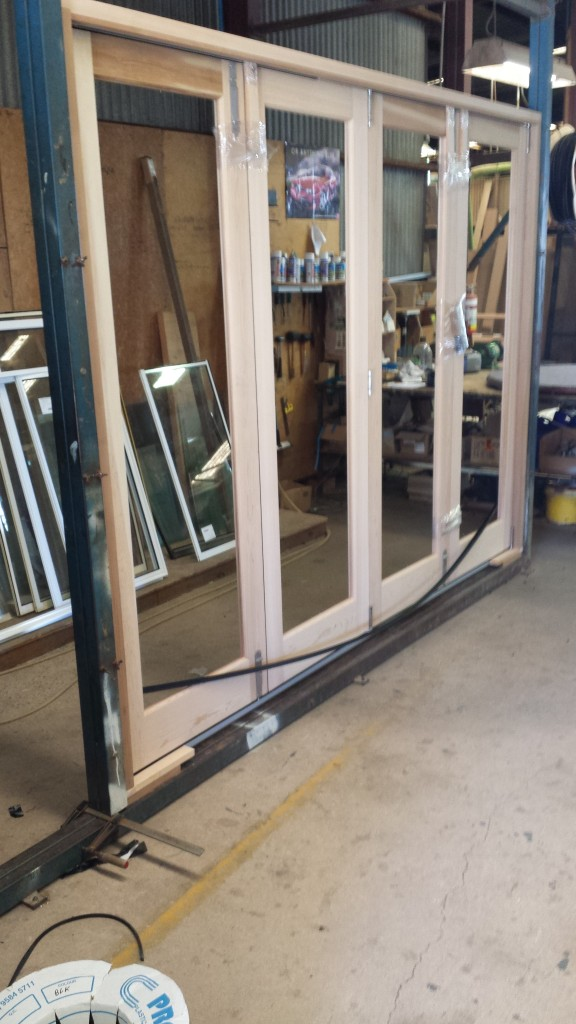 Cedar bifold door. Sitting in our jig to ensure the frame is square, and the doors work perfectly before being sent to the client.