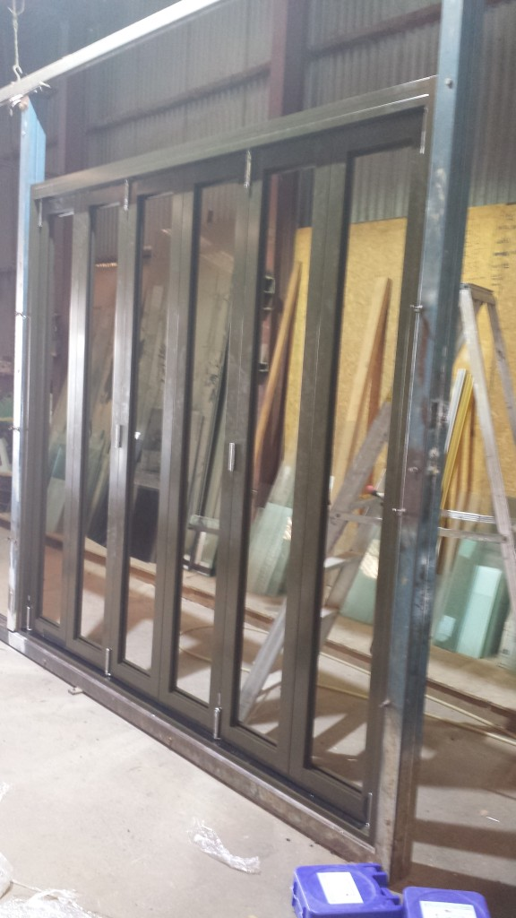 Aluminium Bifold door. Sitting in our factory jig to ensure the doors operate perfectly before being sent out on site.