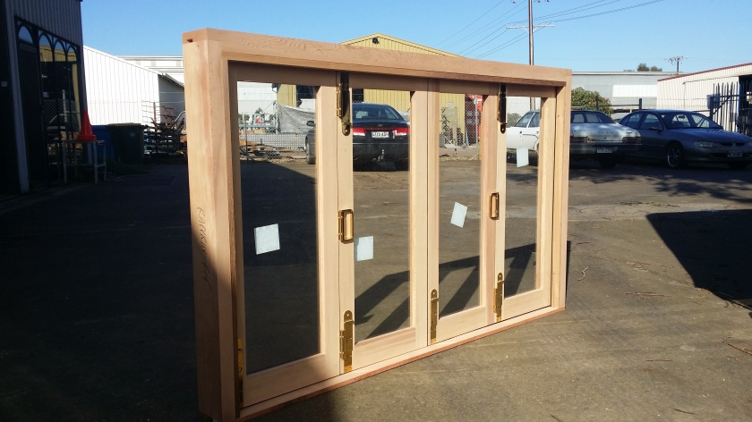 Cedar 4 Bifold Window, gold CENTOR hardware, top hung