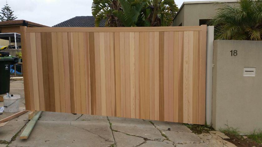 Hanging the cedar gate we had made earlier